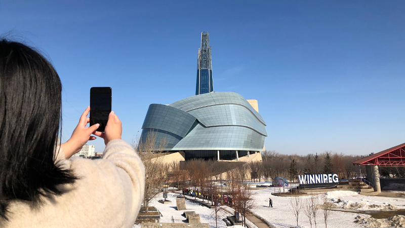 person-taking-phone-photo-of-CMHR.jpg (277 KB)